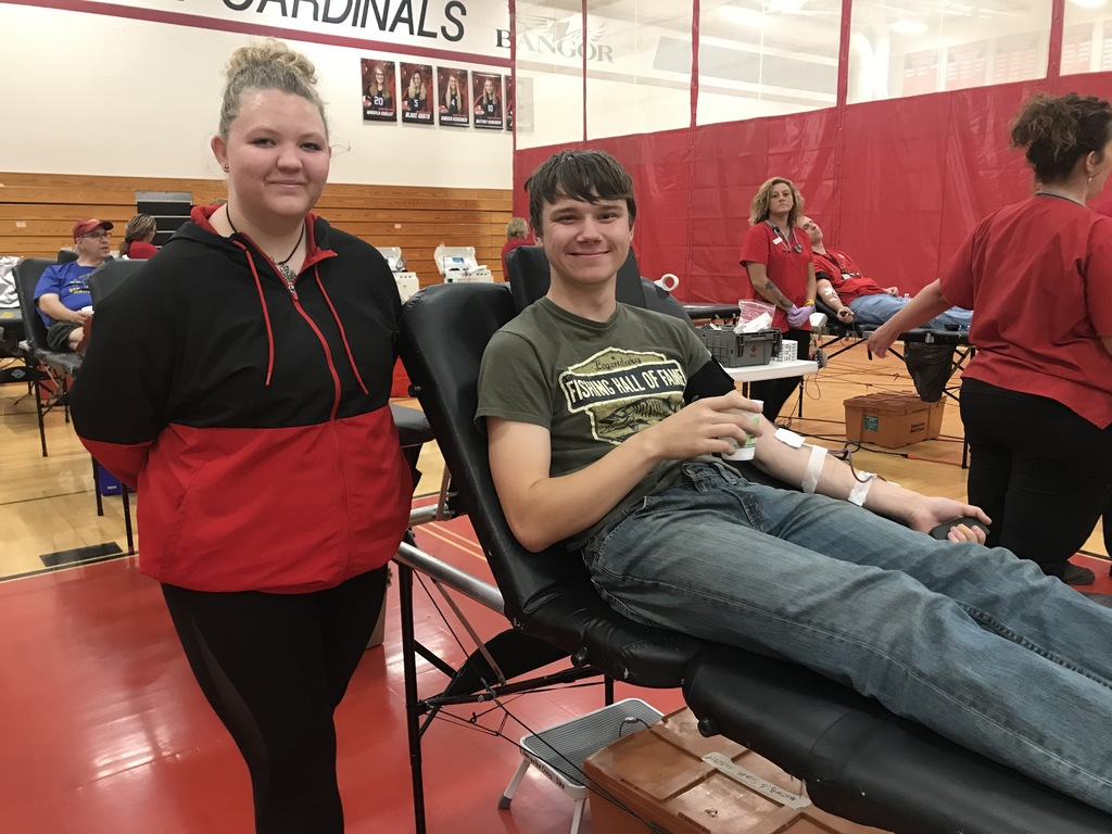 Karissa Adams supports Talon Zager during his blood donation.